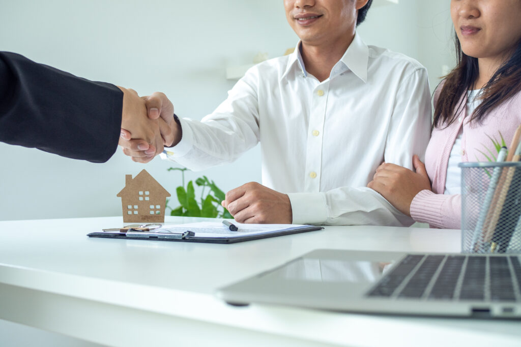 A handshake during a mortgage closing.