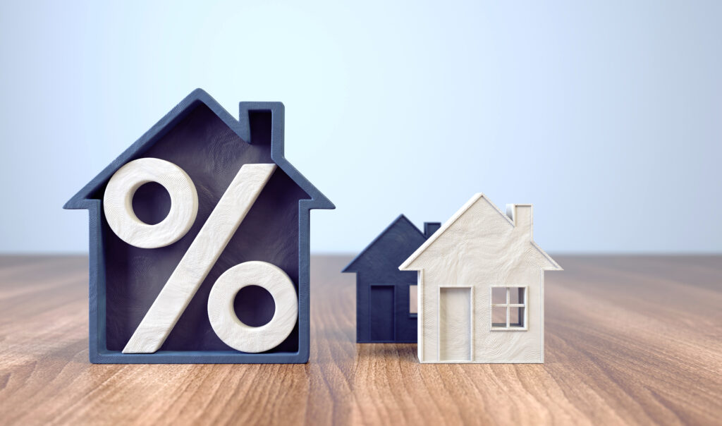 Mortgage Rates. A % Sign and a House Cut Out