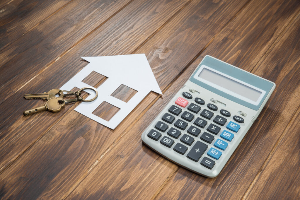 A House and Keys With Calculator